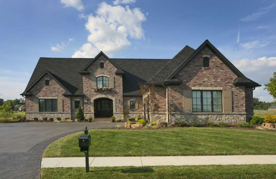 Brick Front Elevation Designs : Traditional brick home front design group